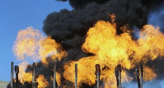 Excess flammable gasses burning from flares at Havana oil field, west of Iraqi city of Kirkuk