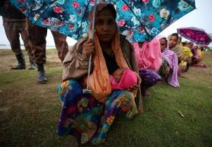 Rohingya refugees in the rain 2 (photo)