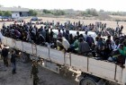 Migrants are transported to detention center in coastal city of Sabratha, Libya in October