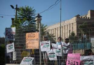 Palestinians hold banners during a protest against Israeli restrictions on the Ibrahimi Mosque in Hebron, occupied West Bank on 28 August 2017