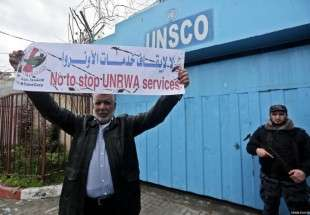 Gazans protest UNRWA funding cuts outside the UN offices in Gaza