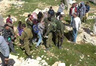 Settlers and soldiers conduct 'joint assaults' on Palestinian village