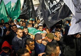 Palestinians hold funeral for teenage boy shot by Israeli forces on Gaza Strip