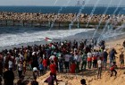 Israeli forces hit, wound dozens of Palestinians in Gaza Strip protest