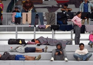 First wave of US-bound Central American asylum seekers arrive in Mexico City