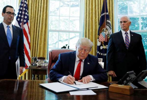 Trump signs 'hard hitting' new sanctions against Iran