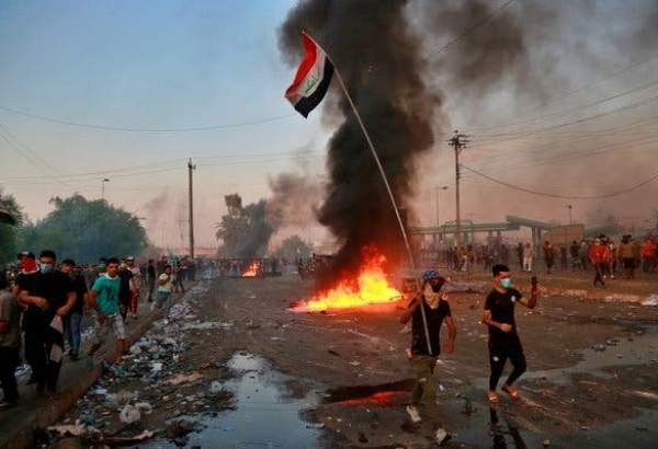 Fresh Baghdad unrest, Washington calls for early vote in Iraq