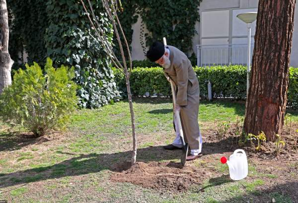 Supreme Leader of Islamic Republic, Seyyed Ali Khamenei, plants two saplings on national Tree Planting Day