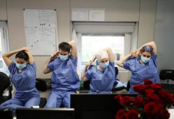 Healthcare workers in Barcelona do yoga on a busy day taking care of coronavirus-infected patients.