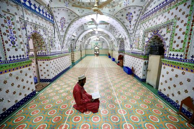 A devotee recites the Quran at a mosque during Ramadan in Dhaka, Bangladesh, on April 26, 2020.