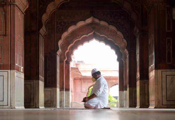 A man offers prayers at Jama Masjid on the first Friday of Ramadan, in the old quarters of Delhi, India, May 1, 2020