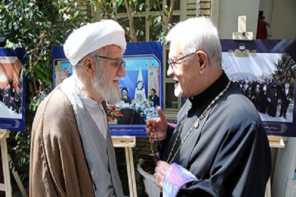 Late Ayatollah Mohammad Ali Taskhiri (L), advisor of the Supreme Leader in Muslim world affairs greeting Sepuh Sarkissian (R), Archbishop of Armenian Christians in Iran