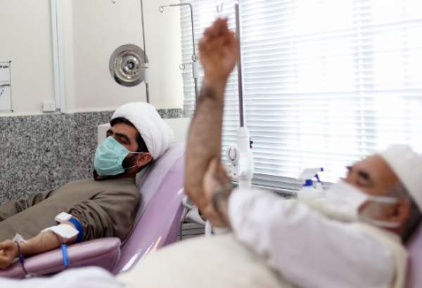 Iranian Shia and Sunni scholar donating blood at blood transmission organization in Southern Khorasan Province.