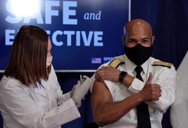 U.S. Surgeon General Jerome Adams gives the thumbs up as he receives the coronavirus vaccine at the White House in Washington, December 18, 2020.