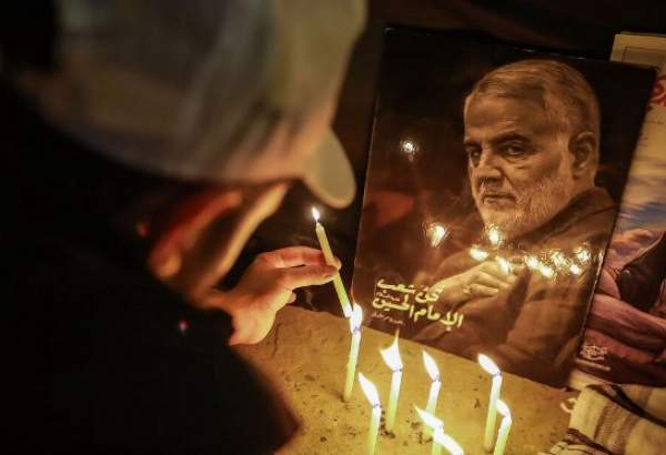 Iraqi young man lights a candle in a vigil held on the first martyrdom anniversary of top Iranian IRGC commander of Quds Force, General Qassem Soleimani and Abu Mahdi Muhandes together with their companions near Baghdad Airport.