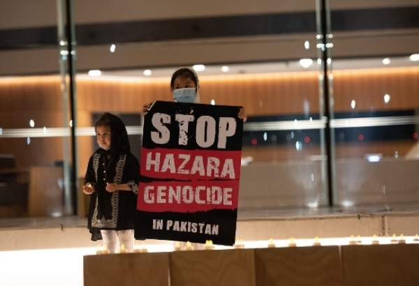 Two Pakistani children hold placard urging for an end to killing of Hazara Muslims in Pakistan on the sideline of a protest held in front of the Parliament of Victoria, Melbourne, Austalia. (photo)